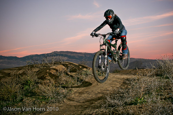 Inga rolls through the beginner table top line while an epic sunset lights the background. . Shot November 2008.