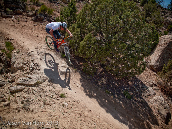 Dylan takes his dirt jumping steeze to his approach on the trail.