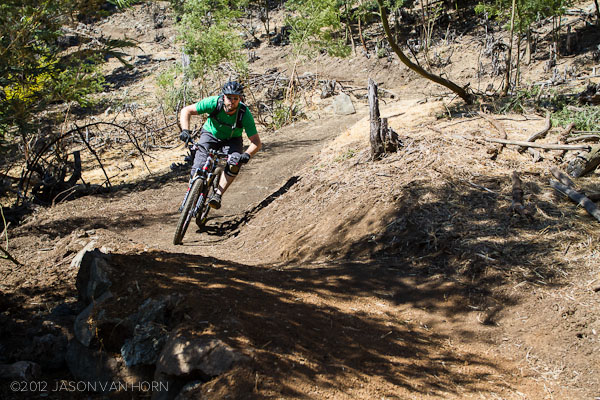 One of the best parts of doing trail work is that you get to be the first to ride the finished result. Adam Labarge checks the flow of the trail.