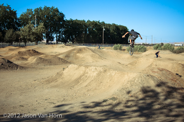 An up and coming local ripper shows some skills with a tuck no hander on a transfer line.