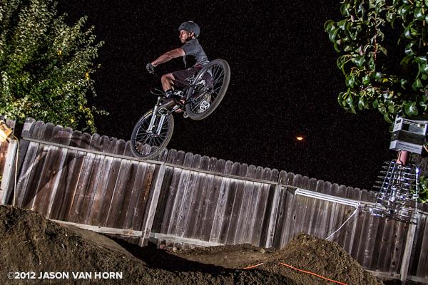 Ian Massey gets sideways on an optimal dirt jump light just left of the roller.