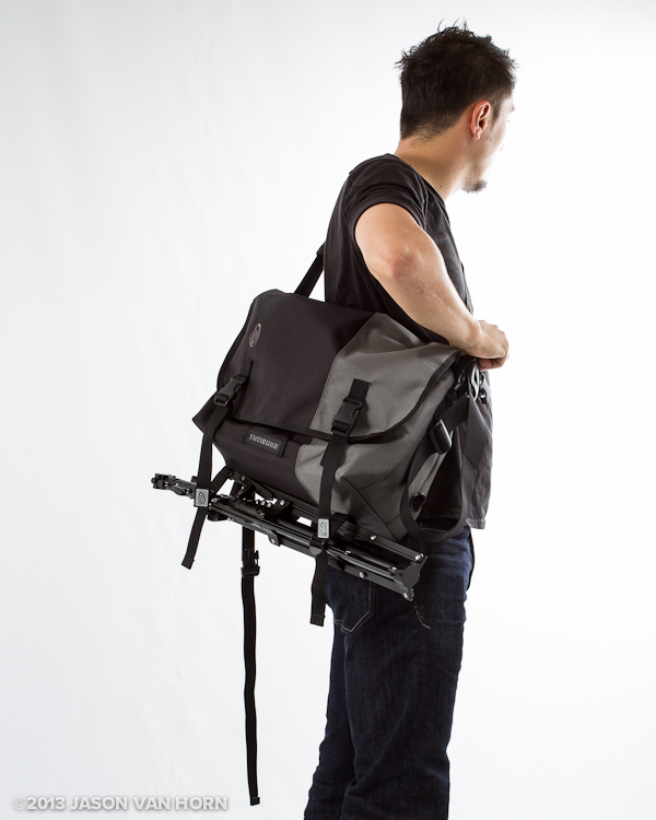 Timbuk2 Snoop Bag with a lightstand attached.