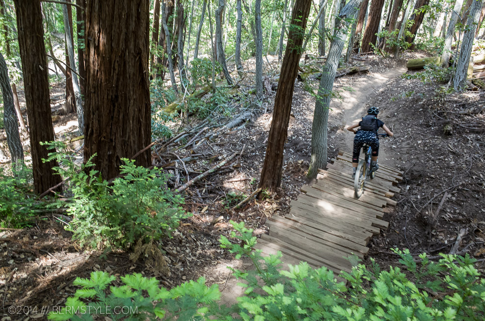 Inga drops into Section 3 of the Demo Flow Trail