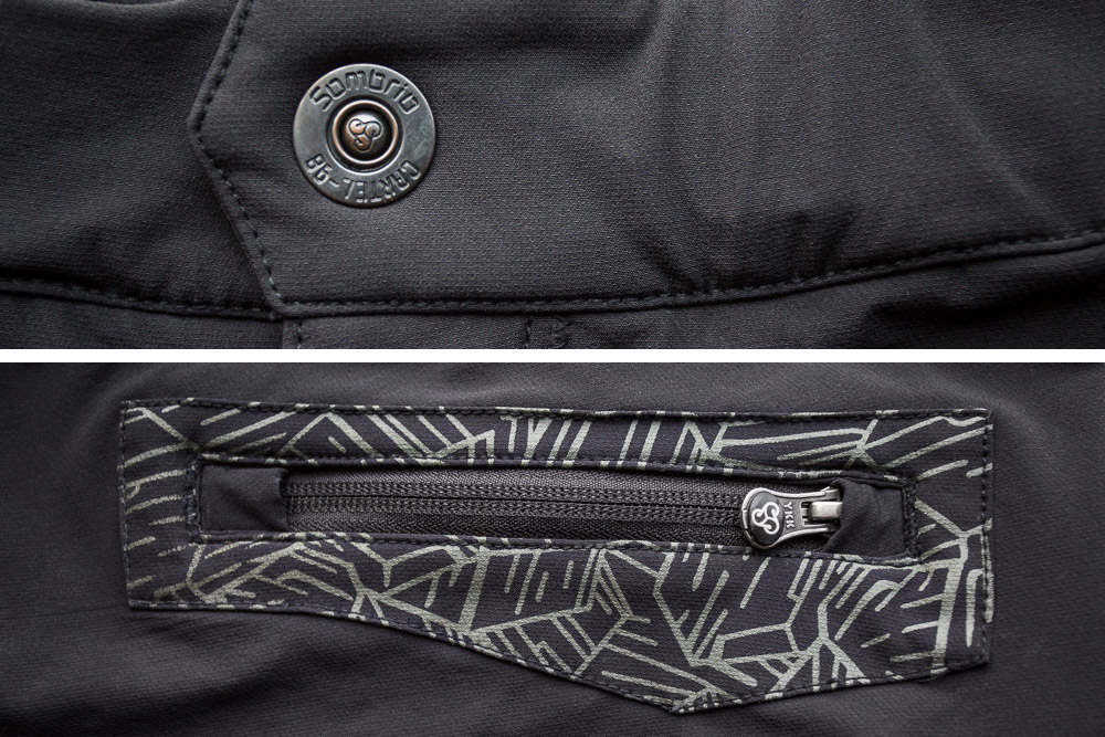 Close up view of the front snap and rear zipper.