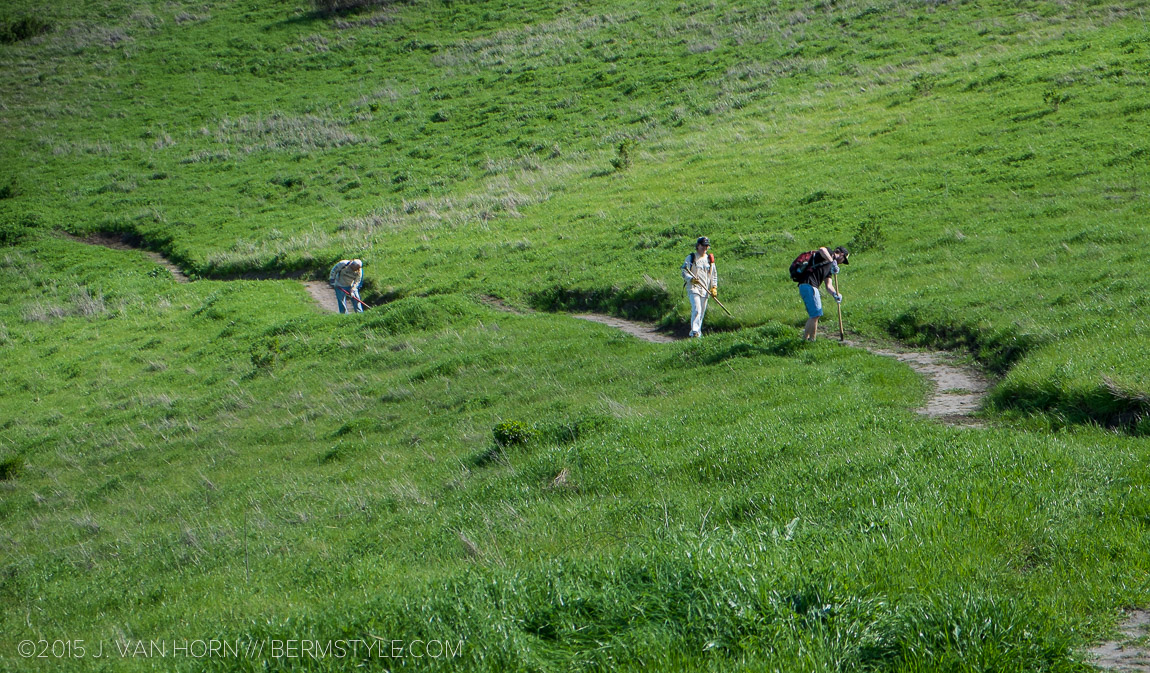 Grass grows quickly here, and what was a four foot wide bench cut has quickly become a narrower ribbon of trail.