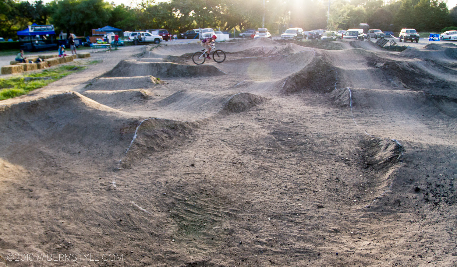 The Aptos Pump Track was a great example of a successful loop-style track. Incorporating alternative lines and features like table top jumps and camel humps in addition to rollers and bermed turns.
