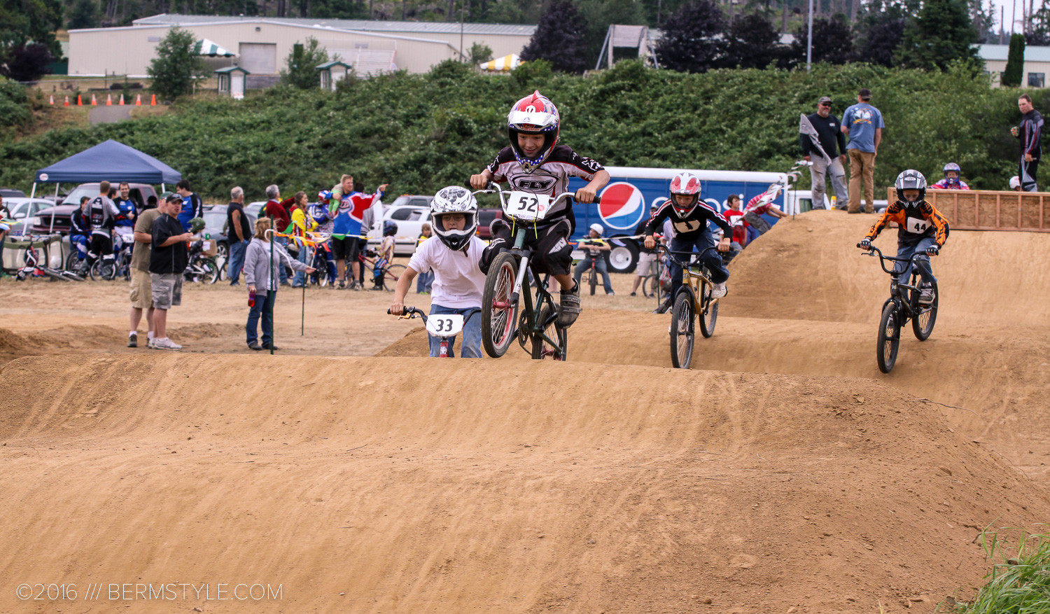 Young riders on a BMX track.