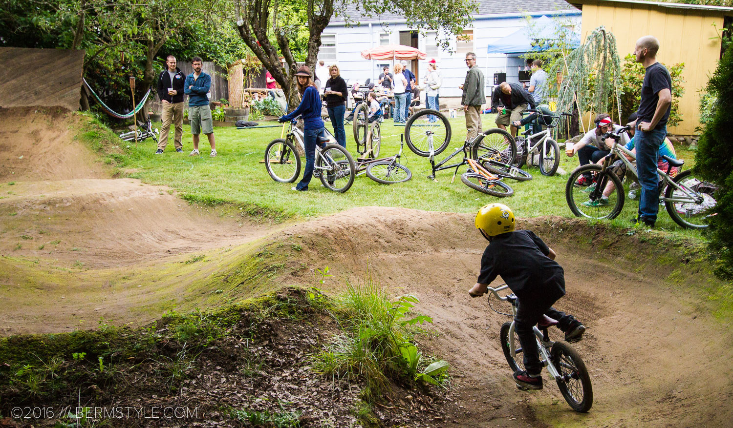 This backyard pump track was small, but using a free flowing layout and skate park like features like dirt quarter pipes and wall rides.