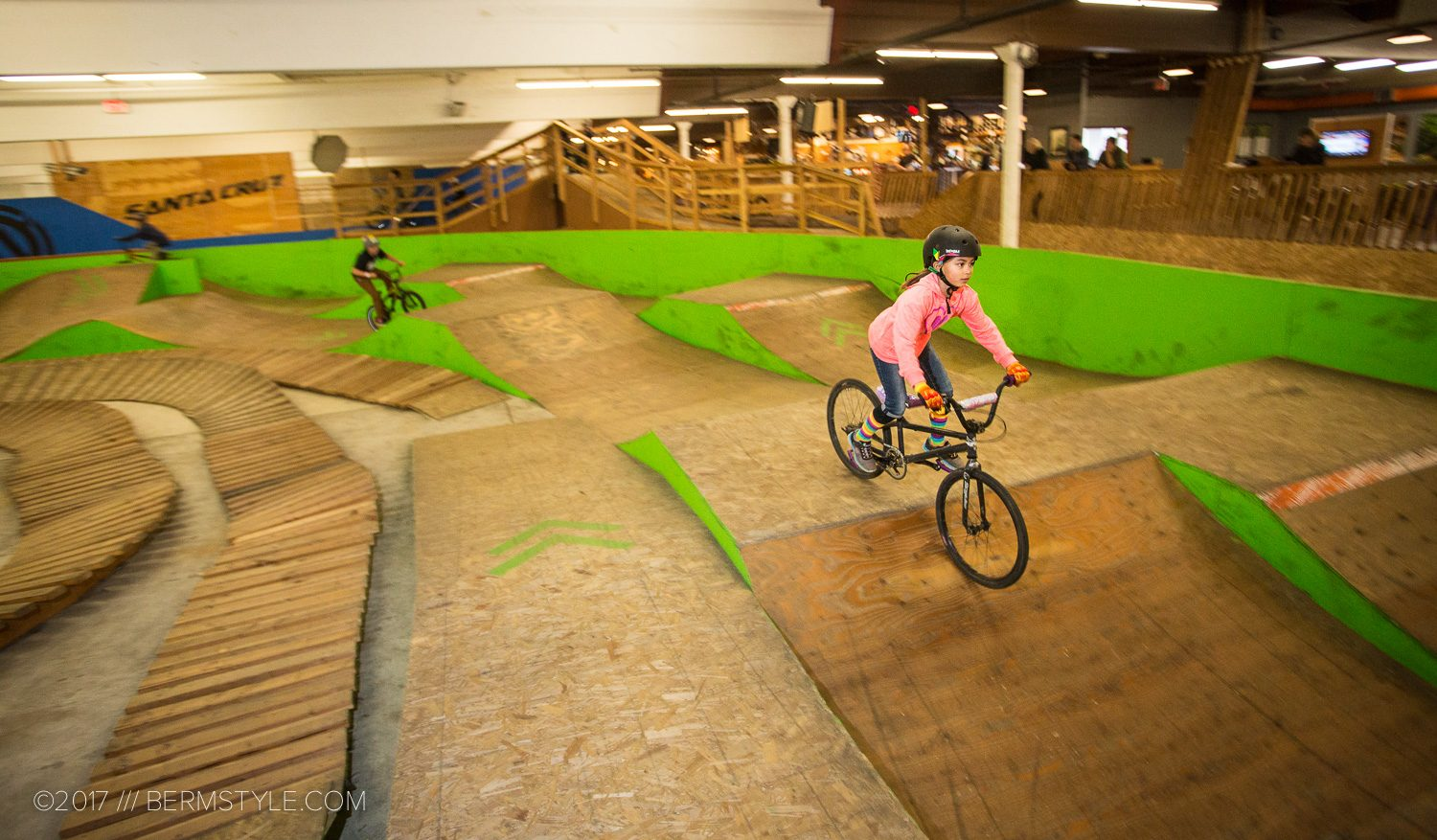 little girl riding her bike at the Lumberyard bike park