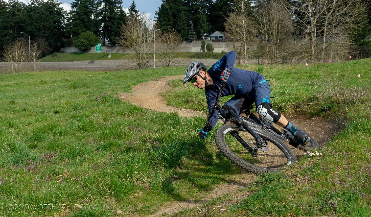 riding a bermed corner at Gateway Green bike park in portland, oregon